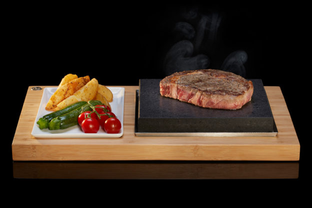 The SteakStones Sizzling Steak Plate Set